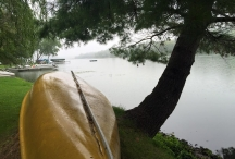 canoe lakeside rainy day